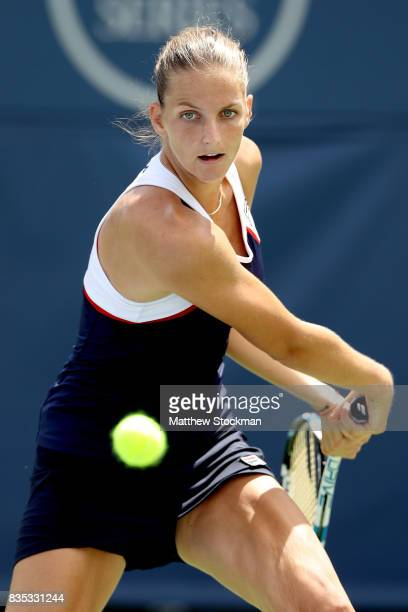 Karolina Pliskova of Czech Republic returns a shot to Camila Giorgi of Italy during day 7 of the Western Southern Open at the Lindner Family Tennis...