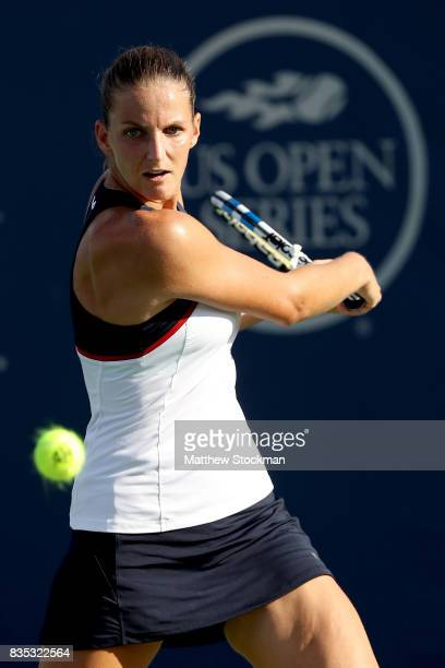 Karolina Pliskova of Czech Republic returns a shot to Caroline Wozniacki of Denmark during day 7 of the Western Southern Open at the Lindner Family...
