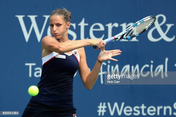 Karolina Pliskova of Czech Republic returns a shot to Garbine Muguruza of Spain during Day 8 of the Western and Southern Open at the Linder Family...