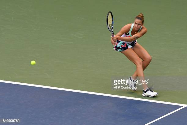 Karolina Pliskova of Czech Republic returns a shot to Magda Linette of Poland during their women's singles second round match at the Pan Pacific Open...