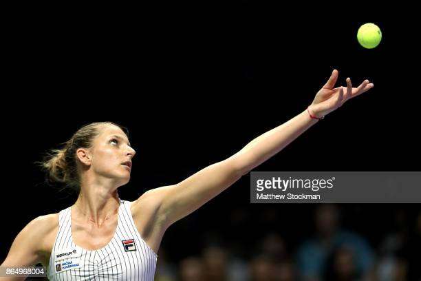 Karolina Pliskova of Czech Republic serves in her singles match against Venus Williams of the United States during day 1 of the BNP Paribas WTA...