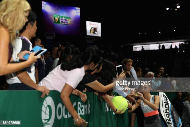 Karolina Pliskova of Czech Republic signs autographs after her victory in the singles match against Venus Williams of the United States during day 1...