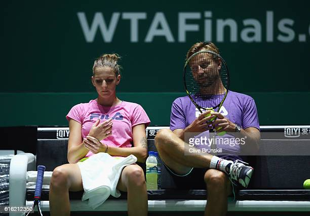 Karolina Pliskova of Czech Republic talks with coach Jiri Vanek during practice prior to the BNP Paribas WTA Finals Singapore at Singapore Sports Hub...