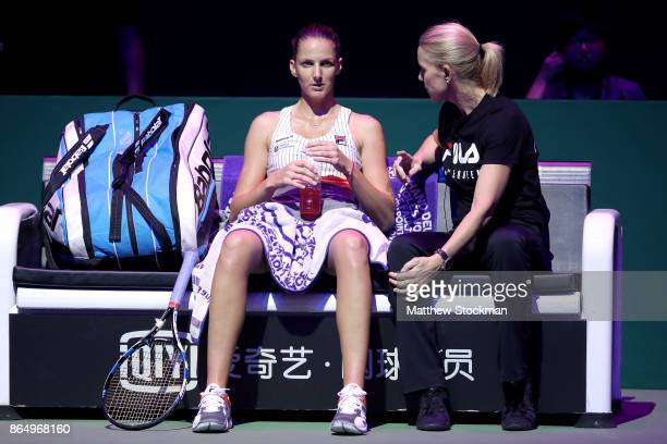 Karolina Pliskova of Czech Republic talks with coach Rennae Stubbs of Australia in her singles match against Venus Williams of the United States...