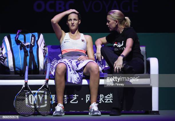 Karolina Pliskova of Czech Republic talks with coach Rennae Stubbs of Australia in her singles match against Jelena Ostapenko of Latvia during day 5...