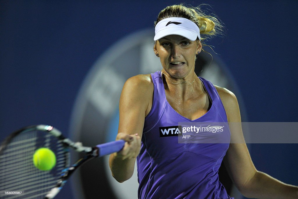 Karolina Pliskova of Czechoslovakia hits a return to Bethanie Mattek-Sands of the United States during their women's final singles match at the BMW Malaysian Open tennis tournament in Kuala Lumpur on March 3, 2013. Pliskova won 1-6, 7-5, 6-3.
