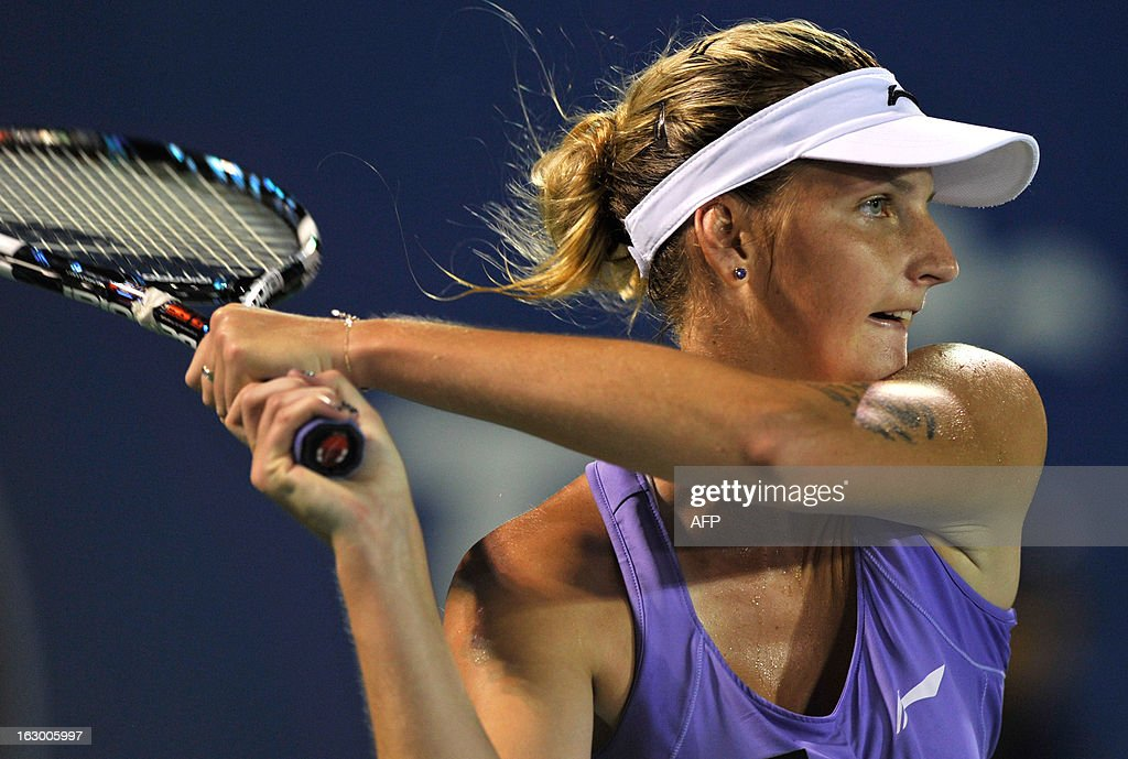 Karolina Pliskova of Czechoslovakia hits a return to Bethanie Mattek-Sands of the United States during their women's final singles match at the BMW Malaysian Open tennis tournament in Kuala Lumpur on March 3, 2013. Pliskova won 1-6, 7-5, 6-3.