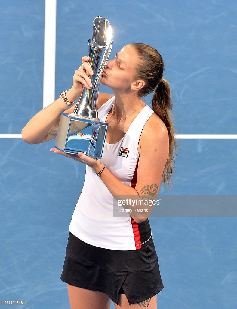 Karolina Pliskova of the Czech Republic celebrates victory as she kisses winners trophy after her match against Alize Cornet of France during the Women's Final on day seven of the 2017 Brisbane International at Pat Rafter Arena on January 7, 2017 in Brisbane, Australia.
