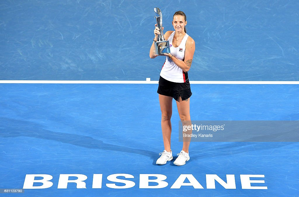 Karolina Pliskova of the Czech Republic celebrates victory as she holds up the winners trophy after her match against Alize Cornet of France during the Women's Final on day seven of the 2017 Brisbane International at Pat Rafter Arena on January 7, 2017 in Brisbane, Australia.