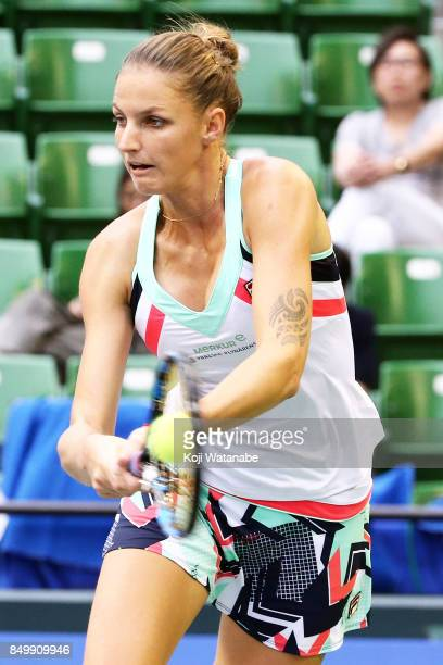 Karolina Pliskova of the Czech Republic plays a backhand in her match against Magda Linette of Poland during day three of the Toray Pan Pacific Open...