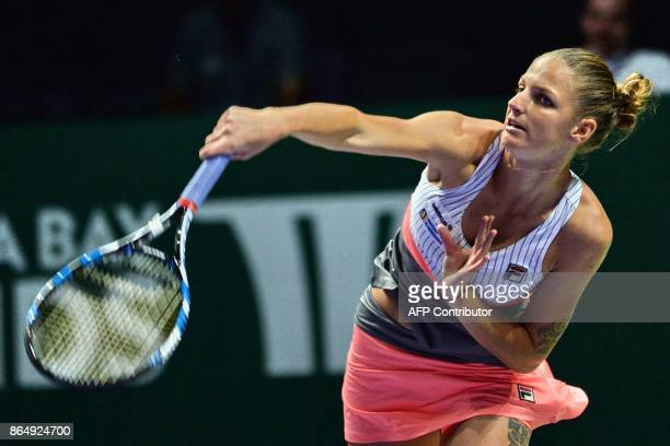 Karolina Pliskova of the Czech Republic plays a shot against Venus Williams of the US during the WTA Finals tennis tournament in Singapore on October...