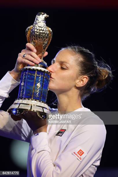 Karolina Pliskova of the Czech Republic poses for a picture with the winner's trophy after winning against Denmark's Caroline Wozniacki during their...
