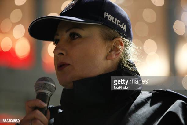 Karolina Poziomka of the local police force is seen speaking to women attending the 1 billion rising 14 February in Bydgoszcz Poland The movement...