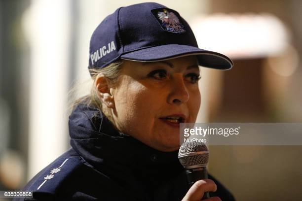 Karolina Poziomka of the local police force is seen speaking to women attending the 1 billion rising event on 14 February in Bydgoszcz Poland The...