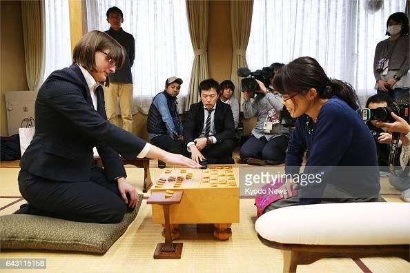 Karolina Styczynska plays a match of the chesslike Japanese board game shogi against professional player Minami Sadamasu in Tokyo on Feb 20 2017 The...