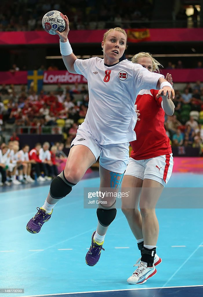 <a gi-track='captionPersonalityLinkClicked' href=/galleries/search?phrase=Karoline+Dyhre+Breivang&family=editorial&specificpeople=4081028 ng-click='$event.stopPropagation()'>Karoline Dyhre Breivang</a> #8 of Norway shoots the ball during the Women's Handball Preliminaries Group A match between Norway and Denmark on Day 7 of the London 2012 Olympic Games at Copper Box on August 3, 2012 in London, England.