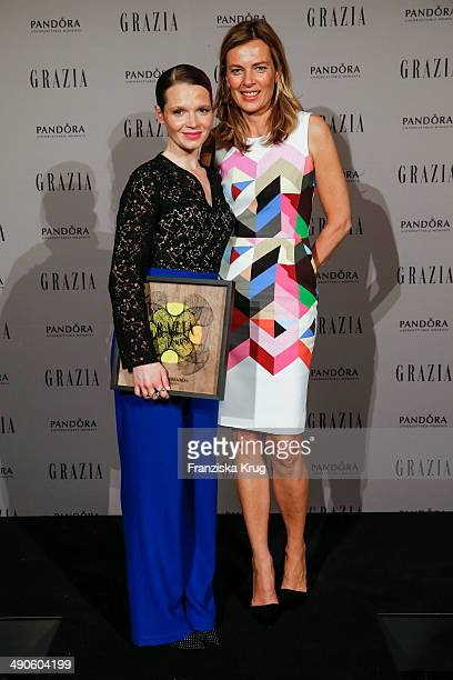 Karoline Herfurth and Astrid Sass attend the Pandora At Grazia Best Dressed Award at Soho House on May 14 2014 in Berlin Germany