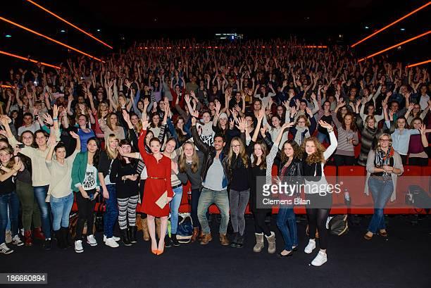 Karoline Herfurth and Elyas M'Barek pose with the audience at the 'Fack Ju Gohte' Berlin Premiere at CineStar on November 2 2013 in Berlin Germany