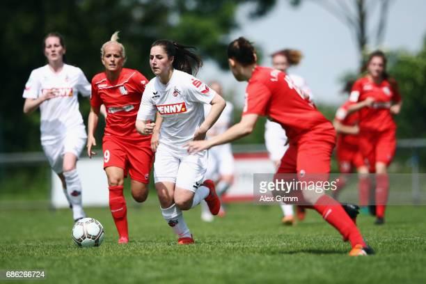 Karoline Kohr of Koeln eludes Michelle Baumann of Niederkirchen during the Second Bundesliga Women South match between FFC Niederkirchen and 1 FC...