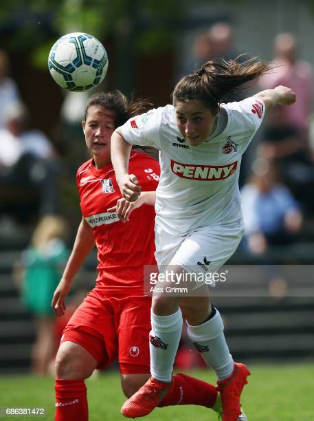 Karoline Kohr of Koeln is challenged by Ann Katrin Striekert of Niederkirchen during the Second Bundesliga Women South match between FFC...