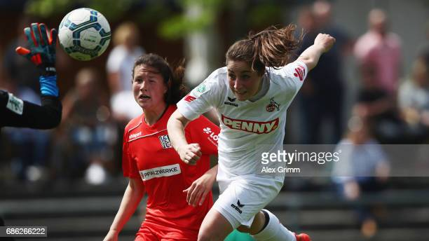 Karoline Kohr of Koeln jumps for a header with Ann Katrin Striekert of Niederkirchen during the Second Bundesliga Women South match between FFC...