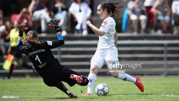 Karoline Kohr of Koeln tries to score past goalkeeper Nadine Winkler of Niederkirchen during the Second Bundesliga Women South match between FFC...