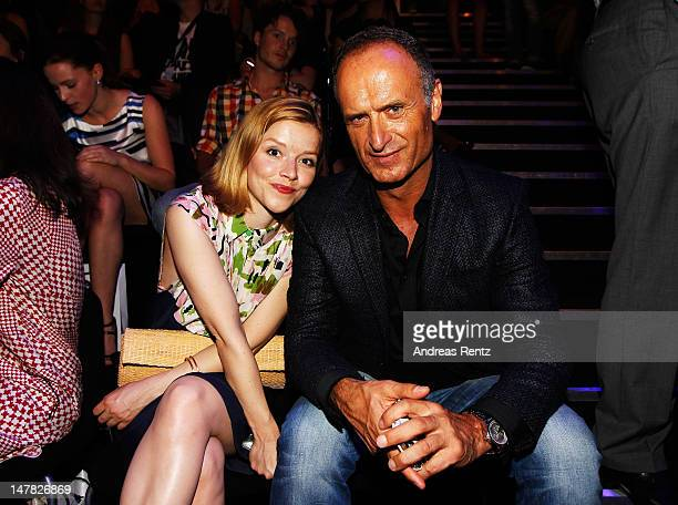 Karoline Schuch and Bruno Saelzer sit in front row during the Designer For Tomorrow show at the MercedesBenz Fashion Week Spring/Summer 2013 on July...