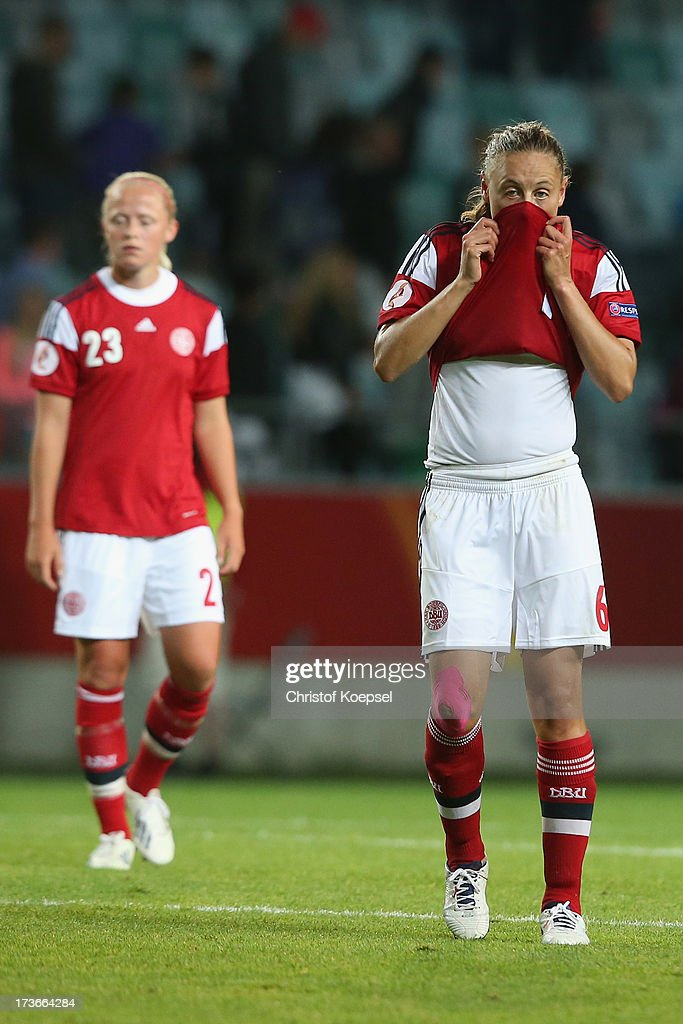 Karoline Smidt Nielsen and Mariann Knudsen of Denmark look dejected after the UEFA Women's EURO 2013 Group A match between Denmark and Finland at Gamla Ullevi Stadium on July 16, 2013 in Gothenburg, Sweden. The match between Denmark and Finland ended 1-1.