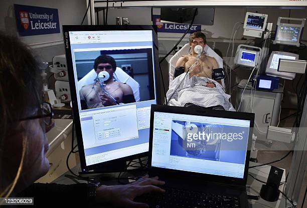 Karoly Keresztes PHD physics student researcher monitors Medical student Tom Eliot as he uses the hightech GBP1million 'sick bay' which has been...