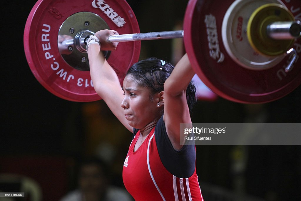 Karool Blanco of Colombia A competes in the Women's 53kg snatch during day two of the 2013 Junior Weightlifting World Championship at Maria Angola Convention Center on April 05, 2013 in Lima, Peru.