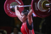 Karool Blanco of Colombia A competes in the Women's 53kg snatch during day two of the 2013 Junior Weightlifting World Championship at Maria Angola...