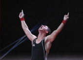 Karrar Mohammed Kadhum of Iraq A celebrates in the Men's 69kg Snatch during day three of the 2013 Junior Weightlifting World Championship at Maria...