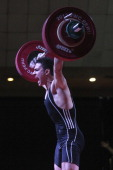 Karrar Mohammed Kadhum of Iraq A competes in the Men's 69kg Snatch during day three of the 2013 Junior Weightlifting World Championship at Maria...