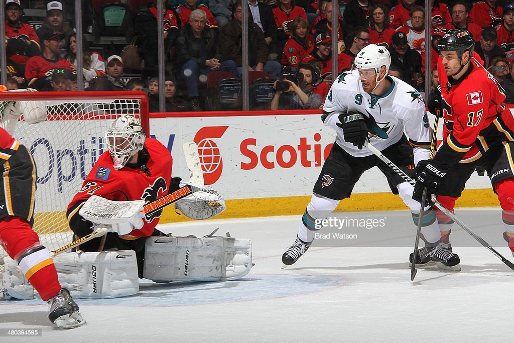 Karri Ramo #31 and Lance Bouma #17 of the Calgary Flames defend the net against Marty Havlat #9 of the San Jose Sharks at Scotiabank Saddledome on March 24, 2014 in Calgary, Alberta, Canada.