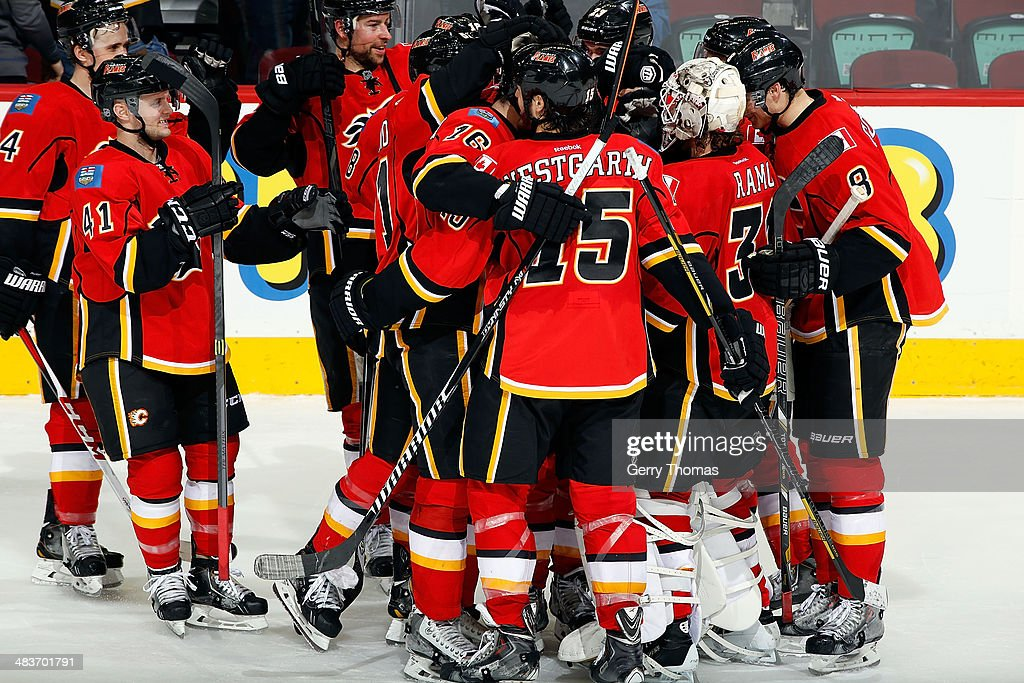 <a gi-track='captionPersonalityLinkClicked' href=/galleries/search?phrase=Karri+Ramo&family=editorial&specificpeople=716721 ng-click='$event.stopPropagation()'>Karri Ramo</a> #31 and teammates of the Calgary Flames celebrate a 4-3 shootout win against the Los Angeles Kings at Scotiabank Saddledome on April 9, 2014 in Calgary, Alberta, Canada.