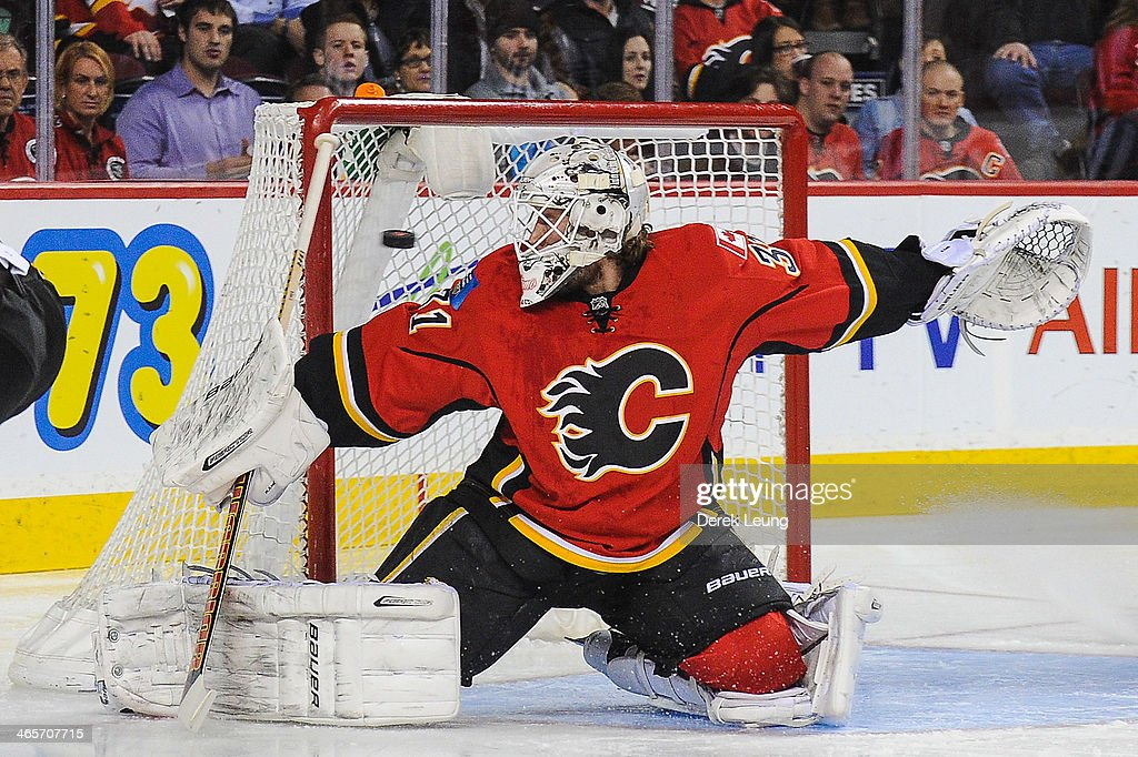 <a gi-track='captionPersonalityLinkClicked' href=/galleries/search?phrase=Karri+Ramo&family=editorial&specificpeople=716721 ng-click='$event.stopPropagation()'>Karri Ramo</a> #31 of the Calgary Flames eyes the puck as he makes a save against the Chicago Blackhawks during an NHL game at Scotiabank Saddledome on January 28, 2014 in Calgary, Alberta, Canada. The Flames defeated the Blackhawks 5-4 in overtime.