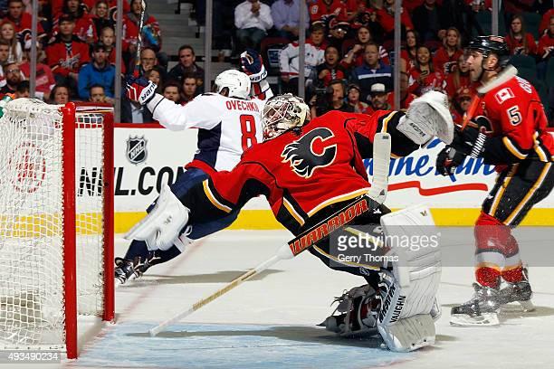 Karri Ramo of the Calgary Flames falls backwards after making a blocker save against the Washington Capitals during an NHL game at Scotiabank...