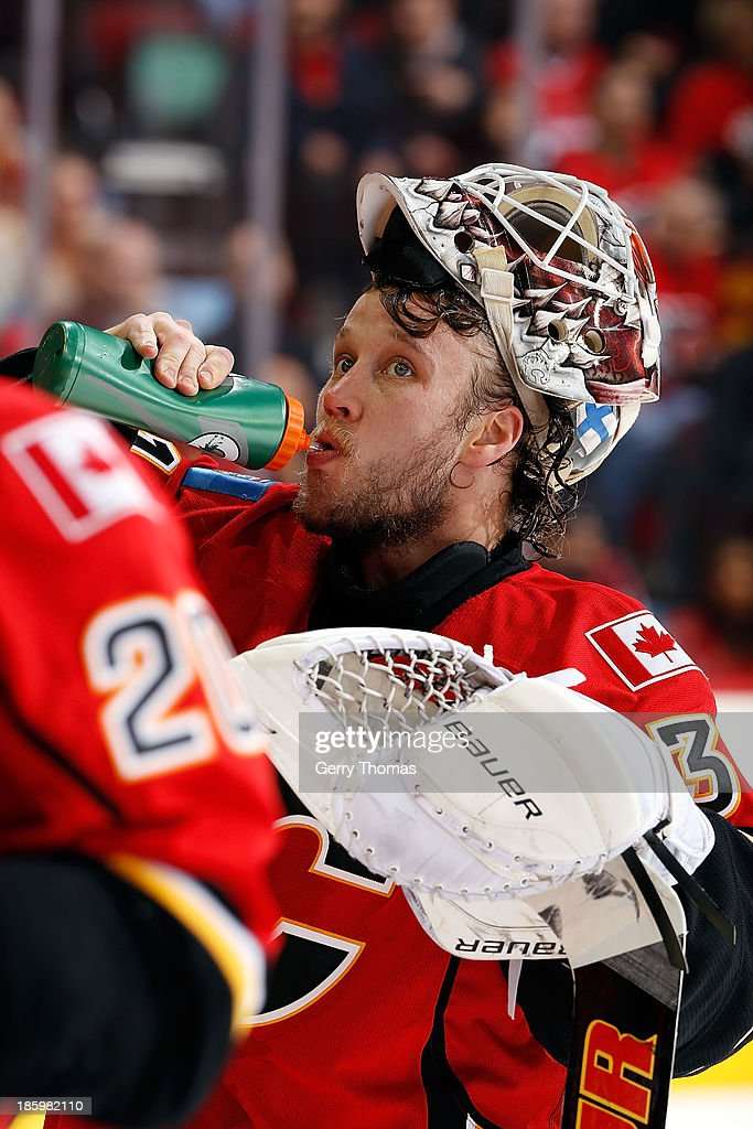 Karri Ramo #31 of the Calgary Flames gets a drink during a stoppage in play against the Washington Capitals at Scotiabank Saddledome on October 26, 2013 in Calgary, Alberta, Canada.