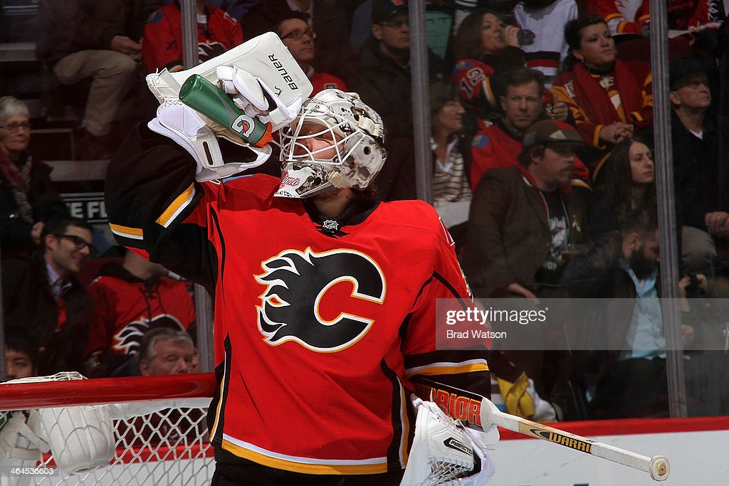 <a gi-track='captionPersonalityLinkClicked' href=/galleries/search?phrase=Karri+Ramo&family=editorial&specificpeople=716721 ng-click='$event.stopPropagation()'>Karri Ramo</a> #31 of the Calgary Flames gets a drink during a stoppage in play against the Phoenix Coyotes at Scotiabank Saddledome on January 22, 2014 in Calgary, Alberta, Canada.