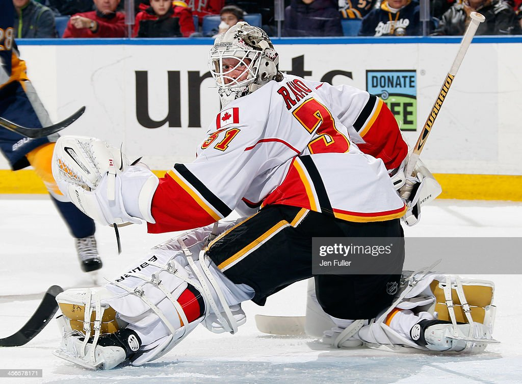 <a gi-track='captionPersonalityLinkClicked' href=/galleries/search?phrase=Karri+Ramo&family=editorial&specificpeople=716721 ng-click='$event.stopPropagation()'>Karri Ramo</a> #31 of the Calgary Flames keeps an eye on the puck against the Buffalo Sabres at First Niagara Center on December 14, 2013 in Buffalo, New York. Calgary defeated Buffalo 2-1.