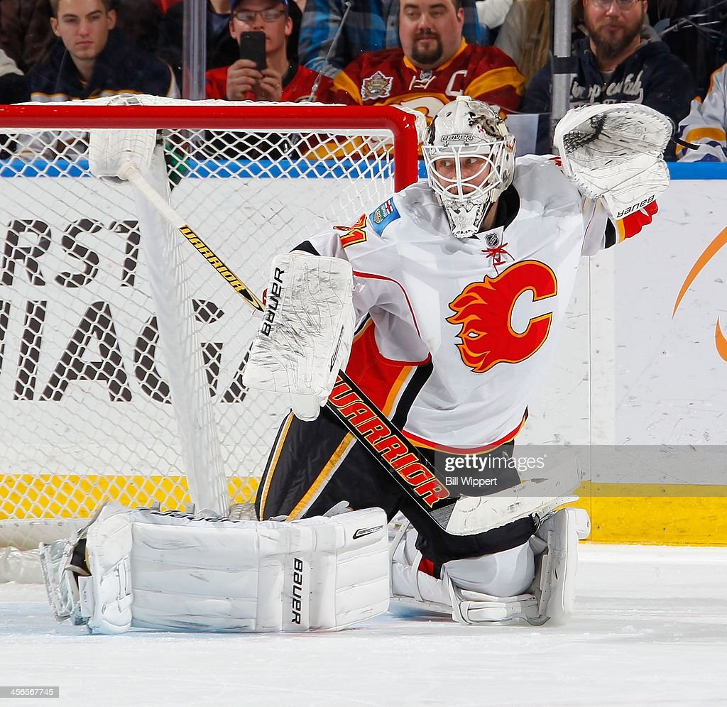 Karri Ramo #31 of the Calgary Flames looks for the puck after a second period shot by Tyler Myers (not shown) of the Buffalo Sabres hit the goal post on December 14, 2013 at the First Niagara Center in Buffalo, New York.