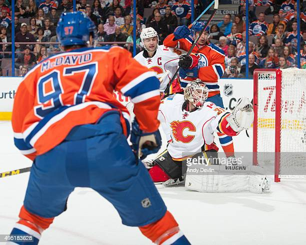 Karri Ramo of the Calgary Flames makes a glove save against the Edmonton Oilers on October 31 2015 at Rexall Place in Edmonton Alberta Canada
