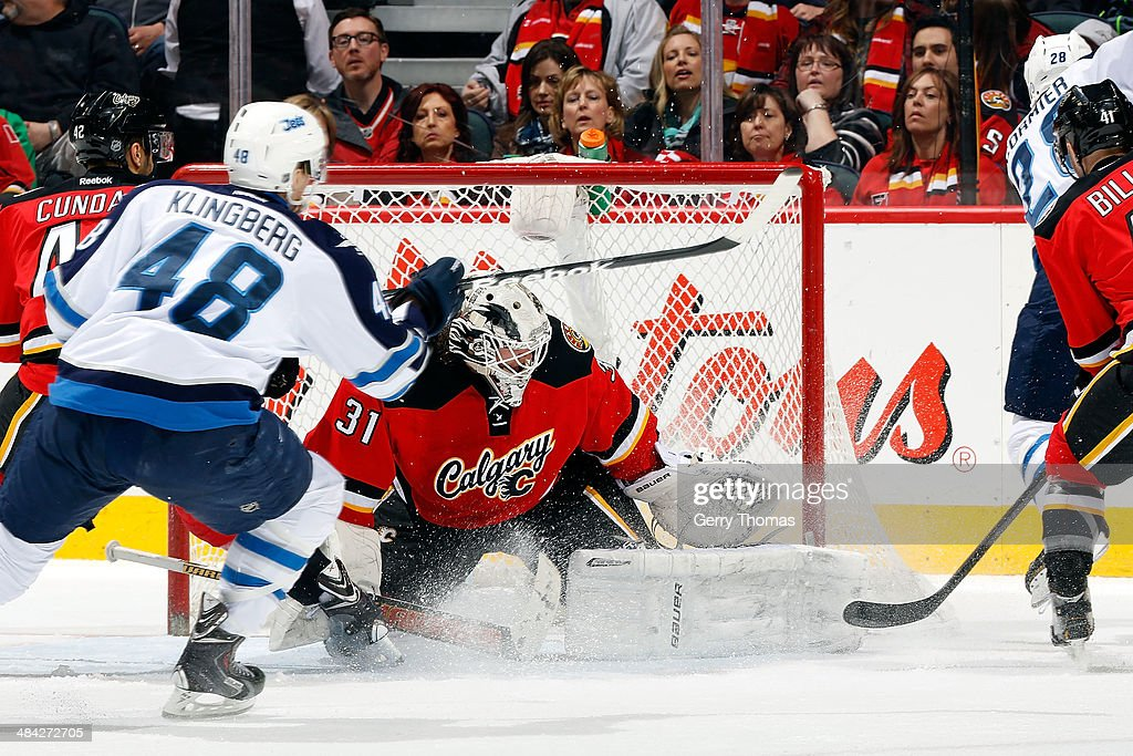 Karri Ramo #31 of the Calgary Flames makes a save against Carl Klingberg #48 of the Winnipeg Jets at Scotiabank Saddledome on April 11, 2014 in Calgary, Alberta, Canada.