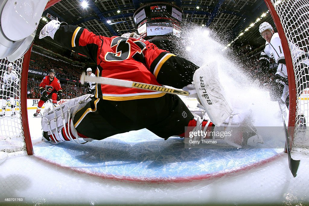 <a gi-track='captionPersonalityLinkClicked' href=/galleries/search?phrase=Karri+Ramo&family=editorial&specificpeople=716721 ng-click='$event.stopPropagation()'>Karri Ramo</a> #31 of the Calgary Flames makes a save against <a gi-track='captionPersonalityLinkClicked' href=/galleries/search?phrase=Marian+Gaborik&family=editorial&specificpeople=202477 ng-click='$event.stopPropagation()'>Marian Gaborik</a> #12 of the Los Angeles Kings at Scotiabank Saddledome on April 9, 2014 in Calgary, Alberta, Canada.