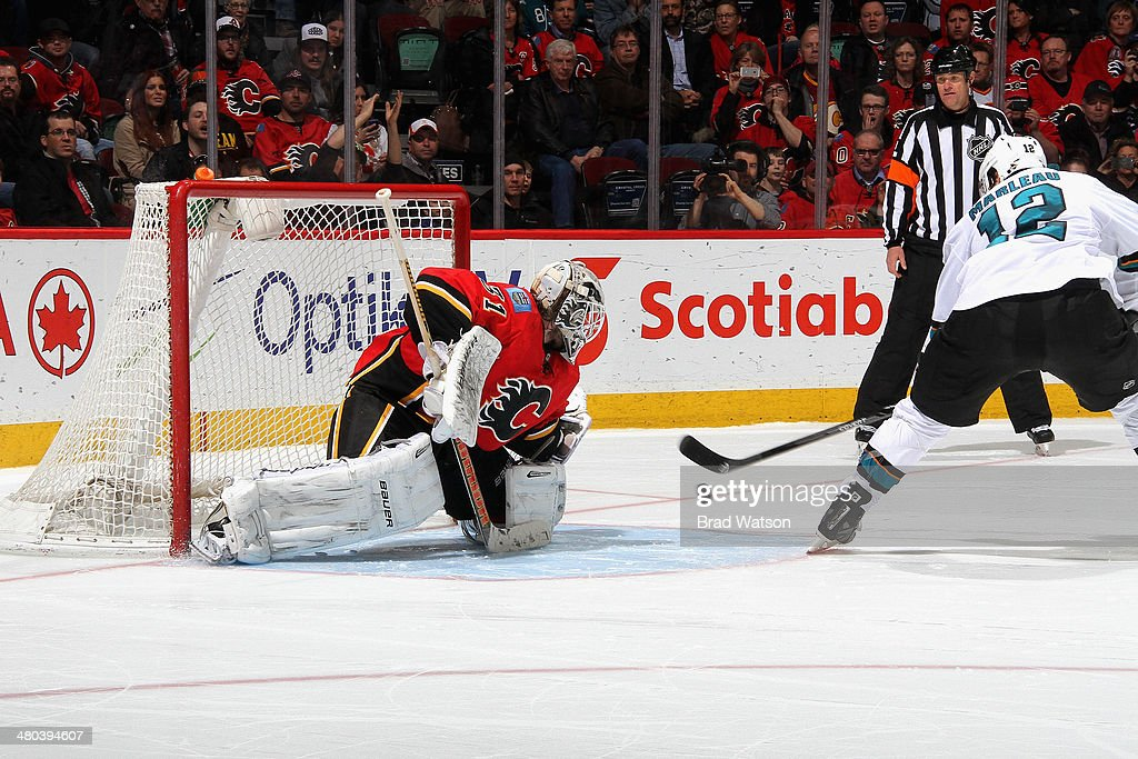 Karri Ramo #31 of the Calgary Flames makes a save in a shootout against Patrick Marleau #12 of the San Jose Sharks at Scotiabank Saddledome on March 24, 2014 in Calgary, Alberta, Canada.