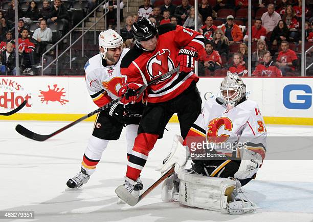 Karri Ramo of the Calgary Flames makes the second period save as Michael Ryder of the New Jersey Devils is checked by Mark Giordano at the Prudential...
