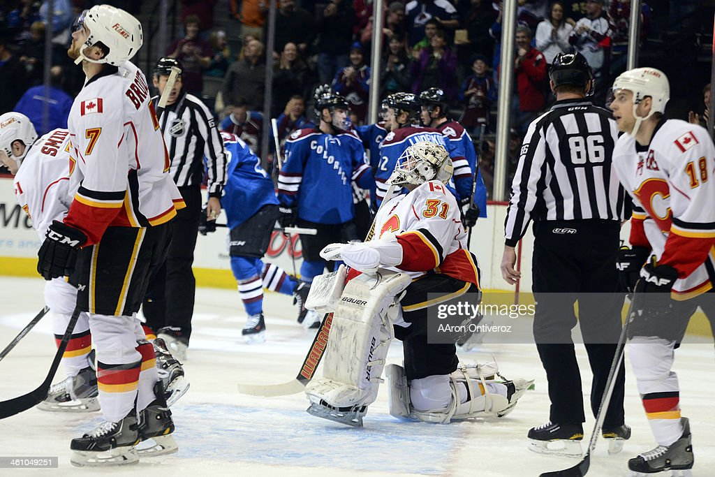 Karri Ramo (31) of the Calgary Flames reacts to giving up a goal to rookie Nathan MacKinnon (29) of the Colorado Avalanche -- the first of two for him in the period -- during the first period of action. The Colorado Avalanche hosted the Calgary Flames at the Pepsi Center on January 06, 2014.