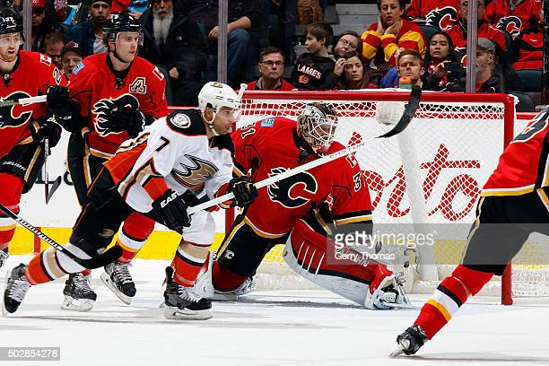 Karri Ramo of the Calgary Flames skates against Andrew Cogliano of the Anaheim Ducks during an NHL game at Scotiabank Saddledome on December 29 2015...