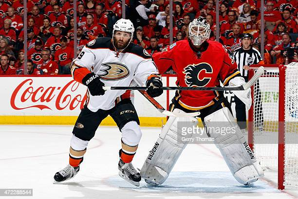 Karri Ramo of the Calgary Flames skates against Patrick Maroon of the Anaheim Ducks at Scotiabank Saddledome for Game Three of the Western...