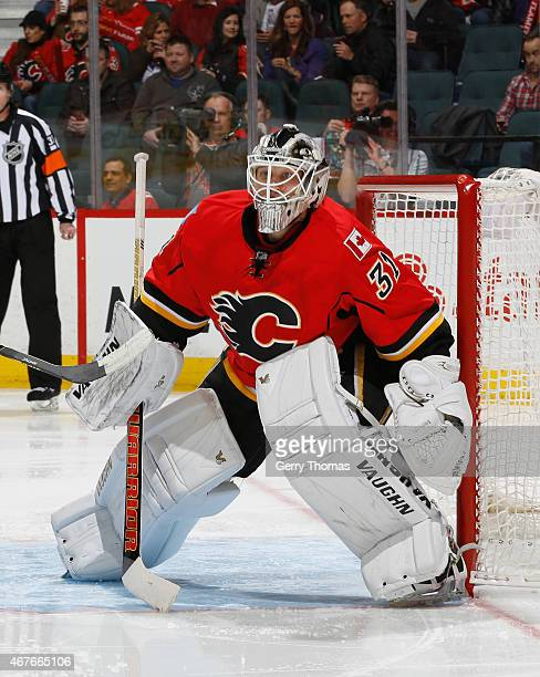 Karri Ramo of the Calgary Flames stays ready in his crease against the Columbus Blue Jackets at Scotiabank Saddledome on March 21 2015 in Calgary...